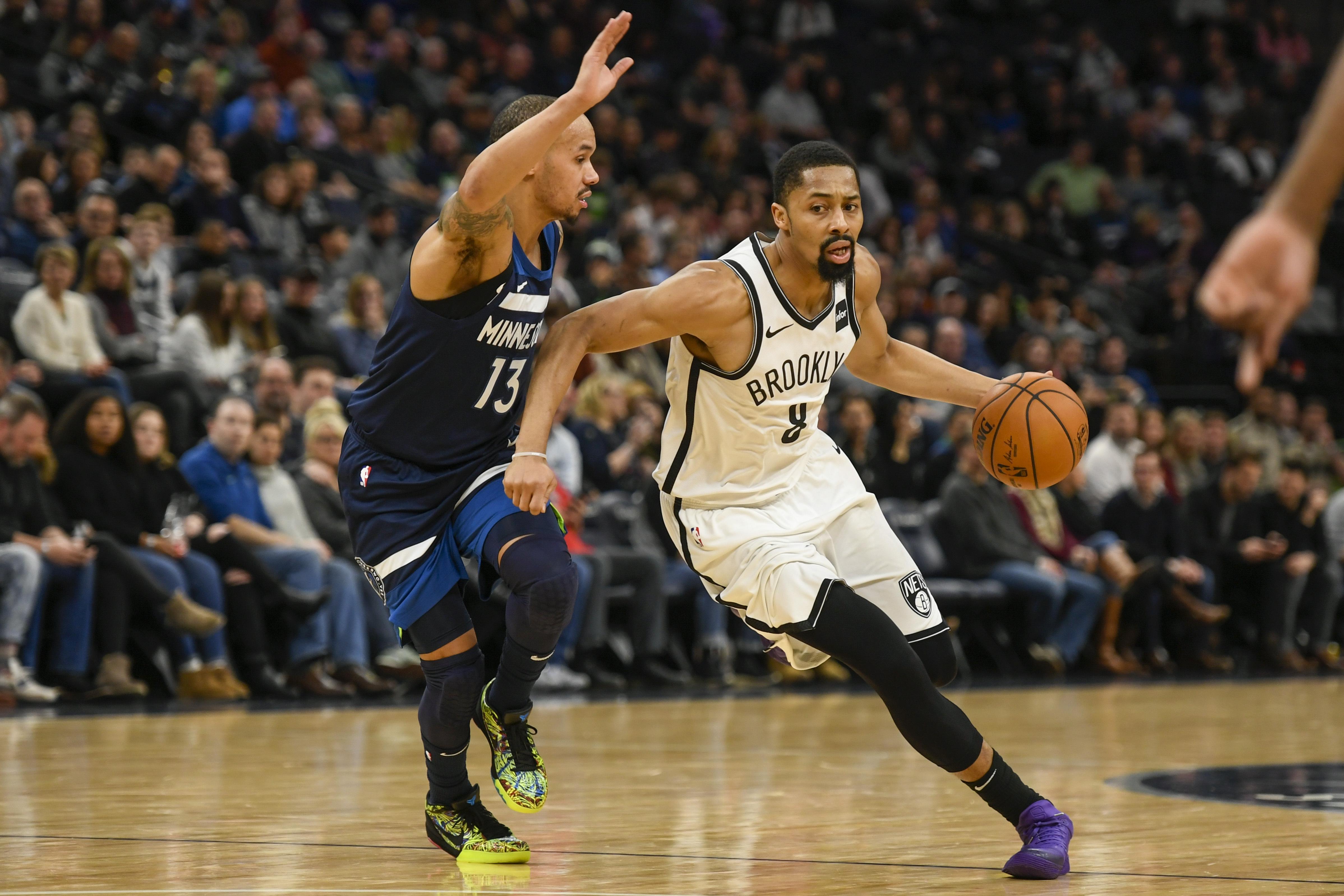 Napier, short-handed Wolves beat Nets 122-115 in OT