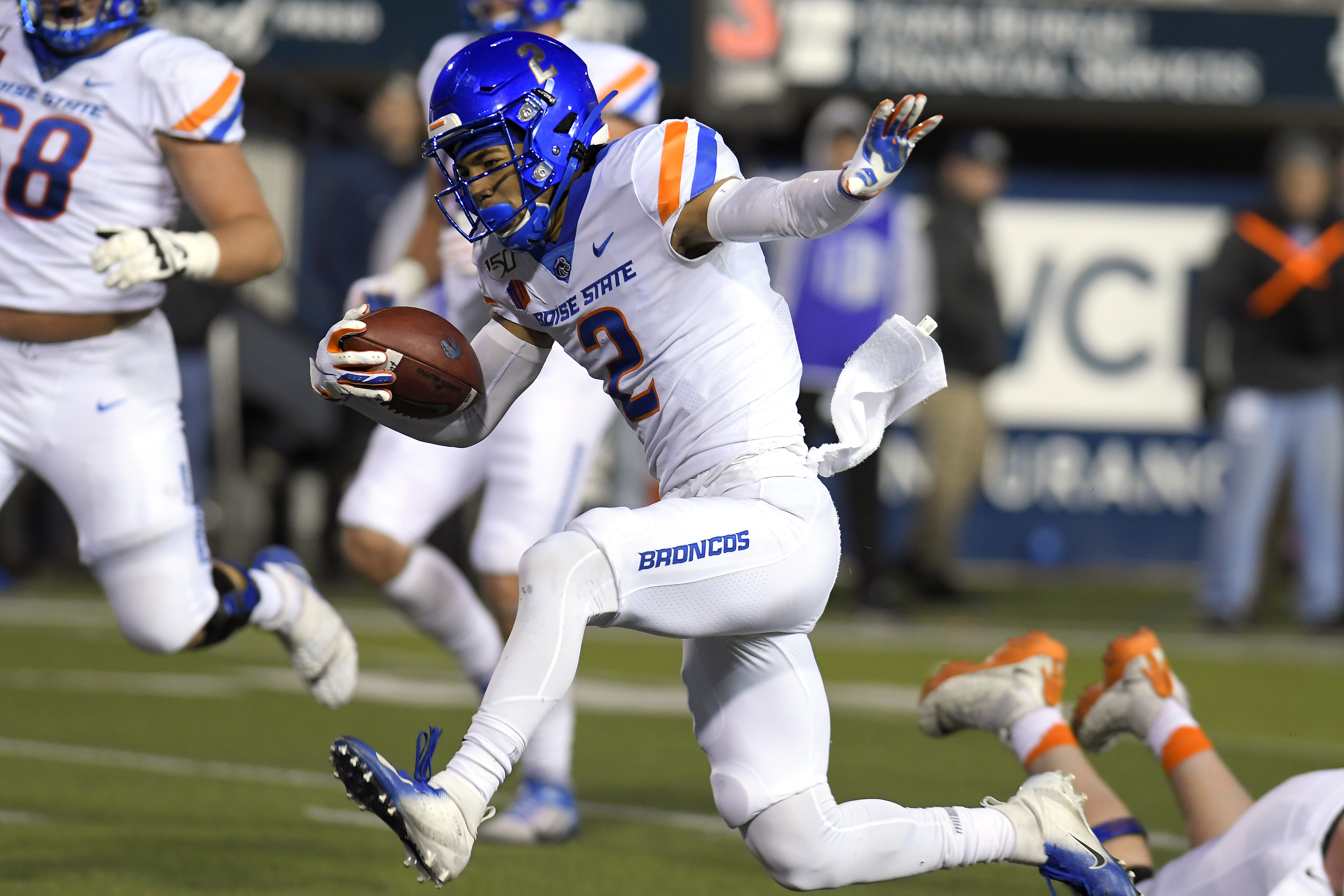 No. 20 Boise State runs over Utah State for 56-21 win