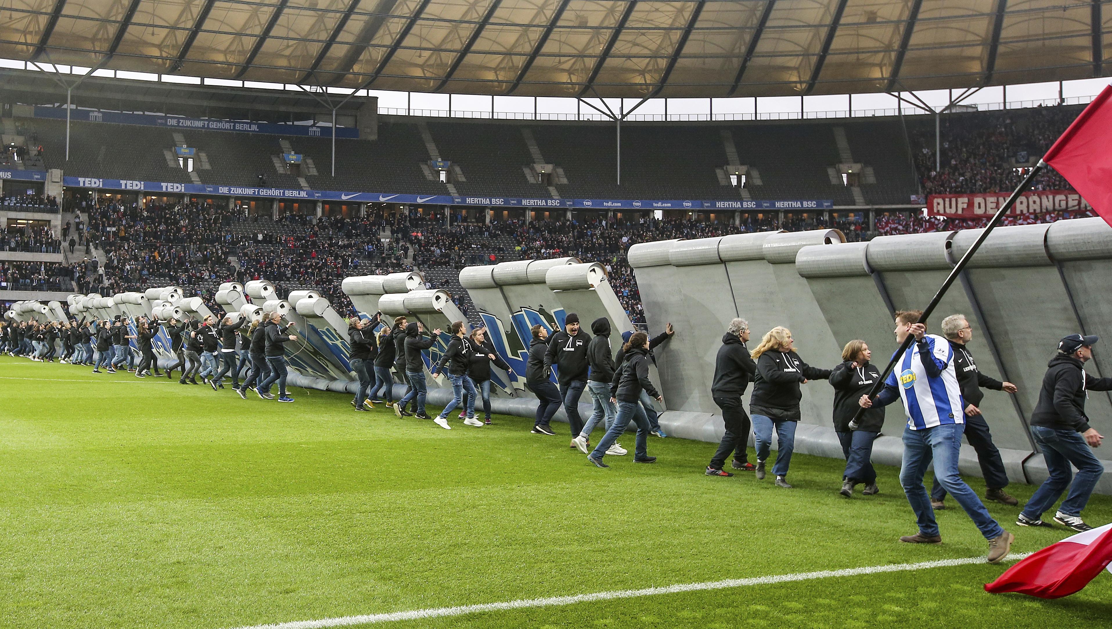 Soccer fans tear down 'Berlin Wall' at Hertha-Leipzig game