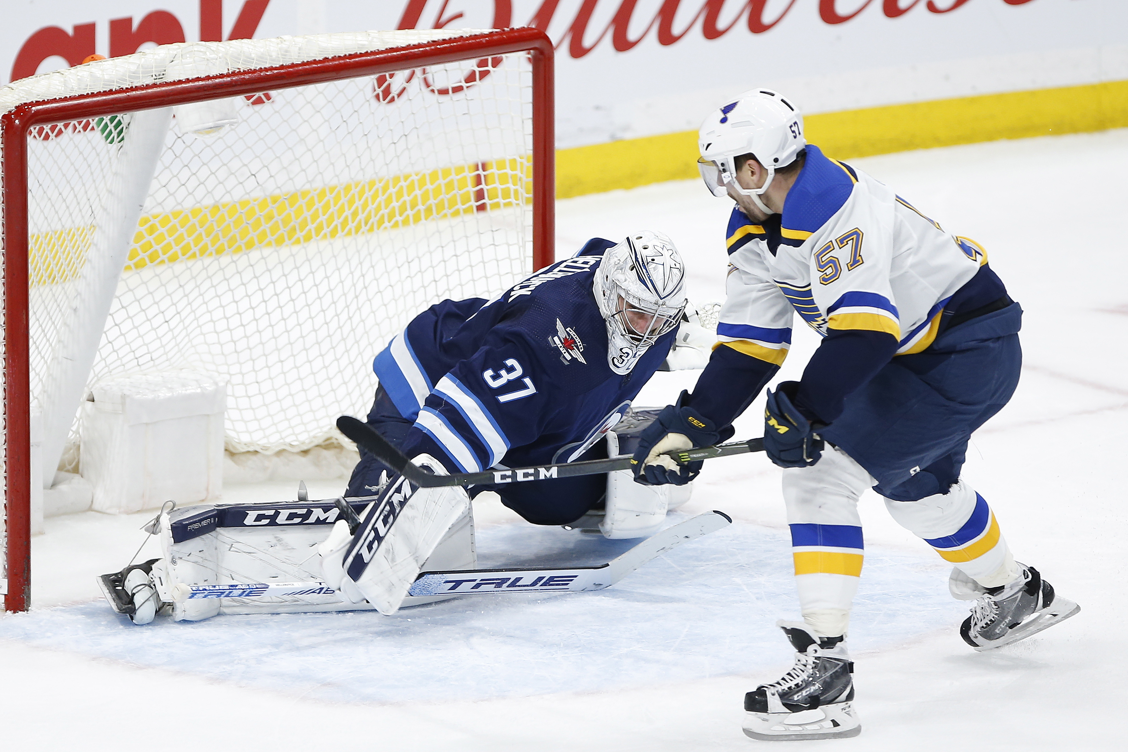 Perron scores in OT; Blues win 7th straight, 5-4 over Jets
