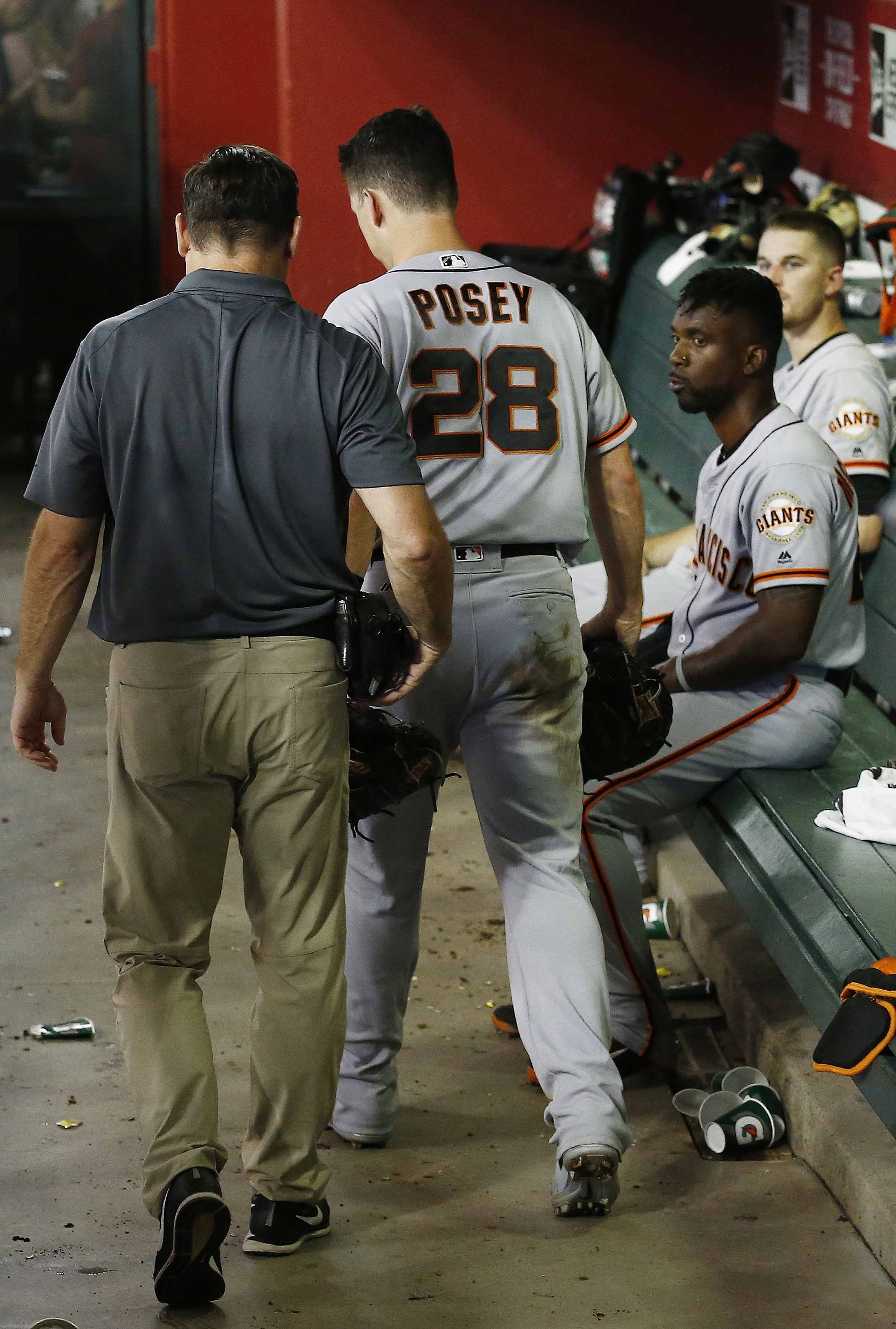 Posey leaves game inning after taking foul ball on mask