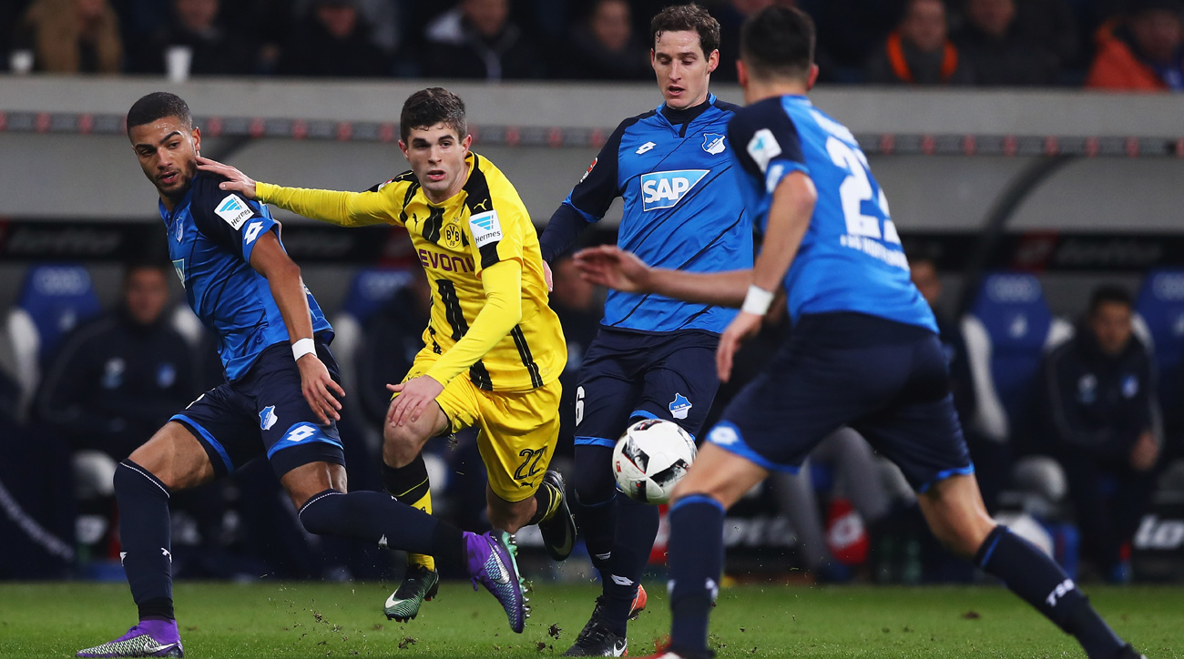 Hoffenheim remains unbeaten, draws 10-man Dortmund 2-2