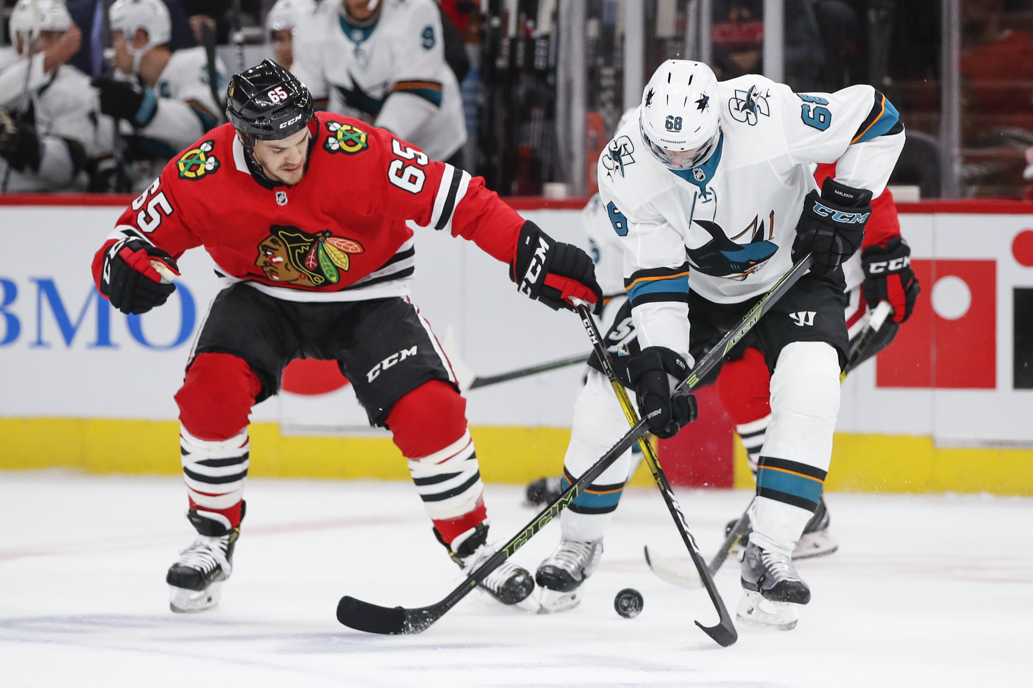 Marleau helps Sharks beat Blackhawks 5-4 for 1st win