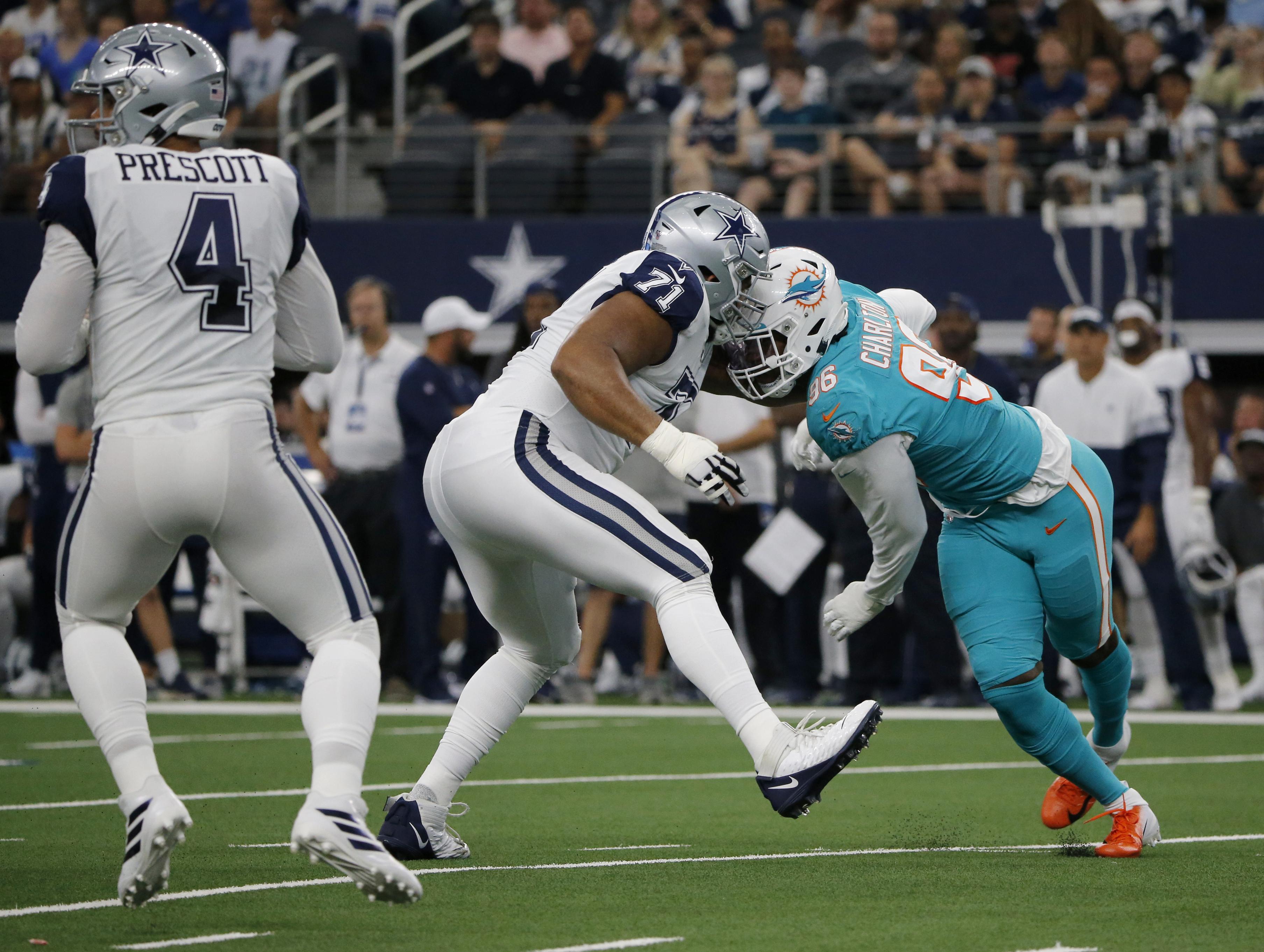 Taco's time with Dolphins starts with sack against Cowboys