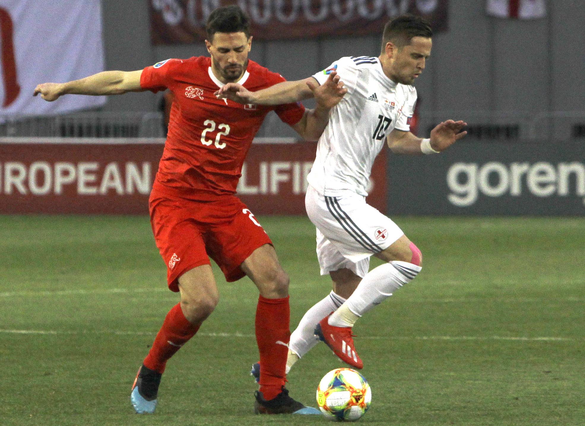 Swiss defender Schar plays on after severe head knock