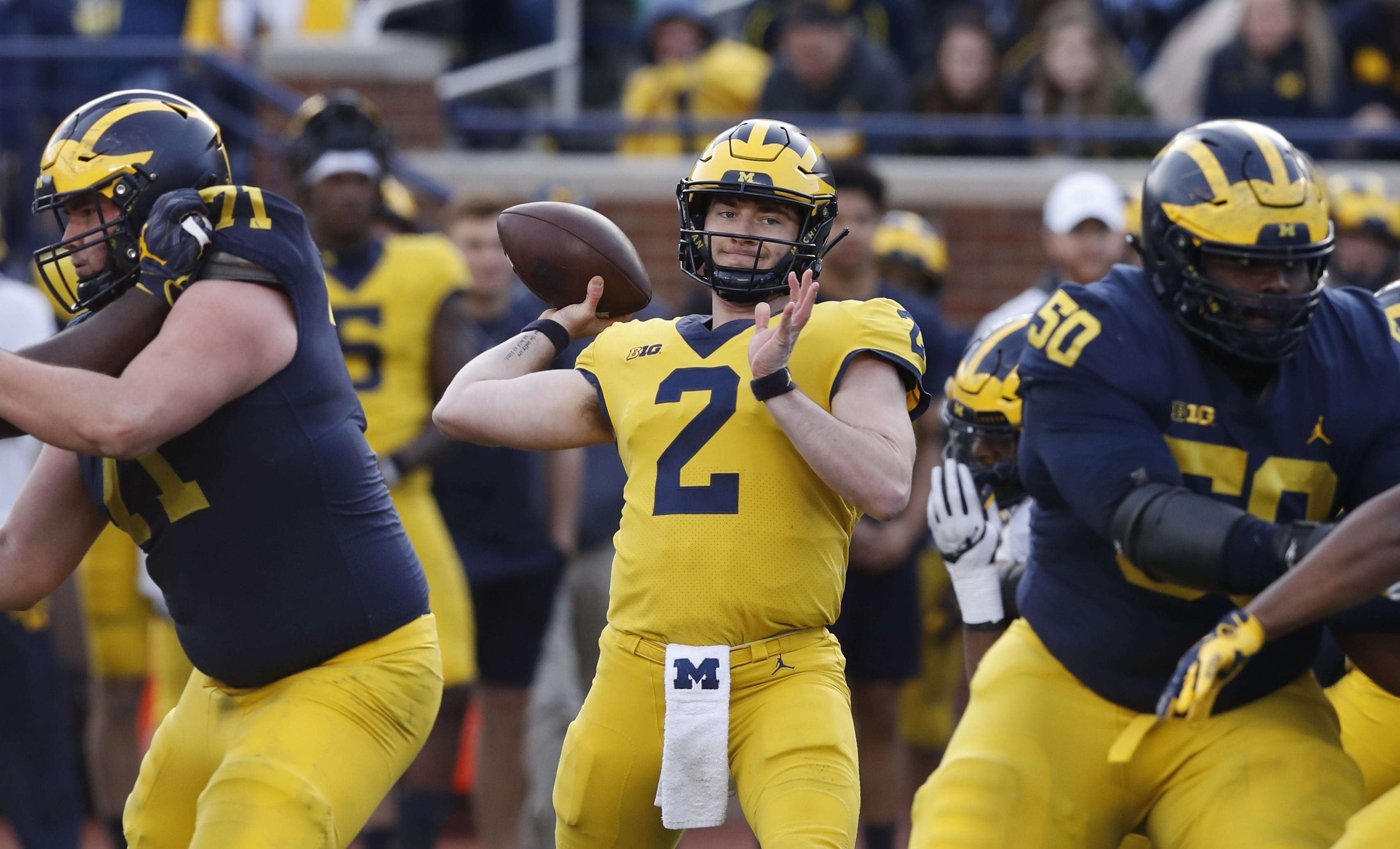 Harbaugh-led Michigan making transition to no-huddle spread
