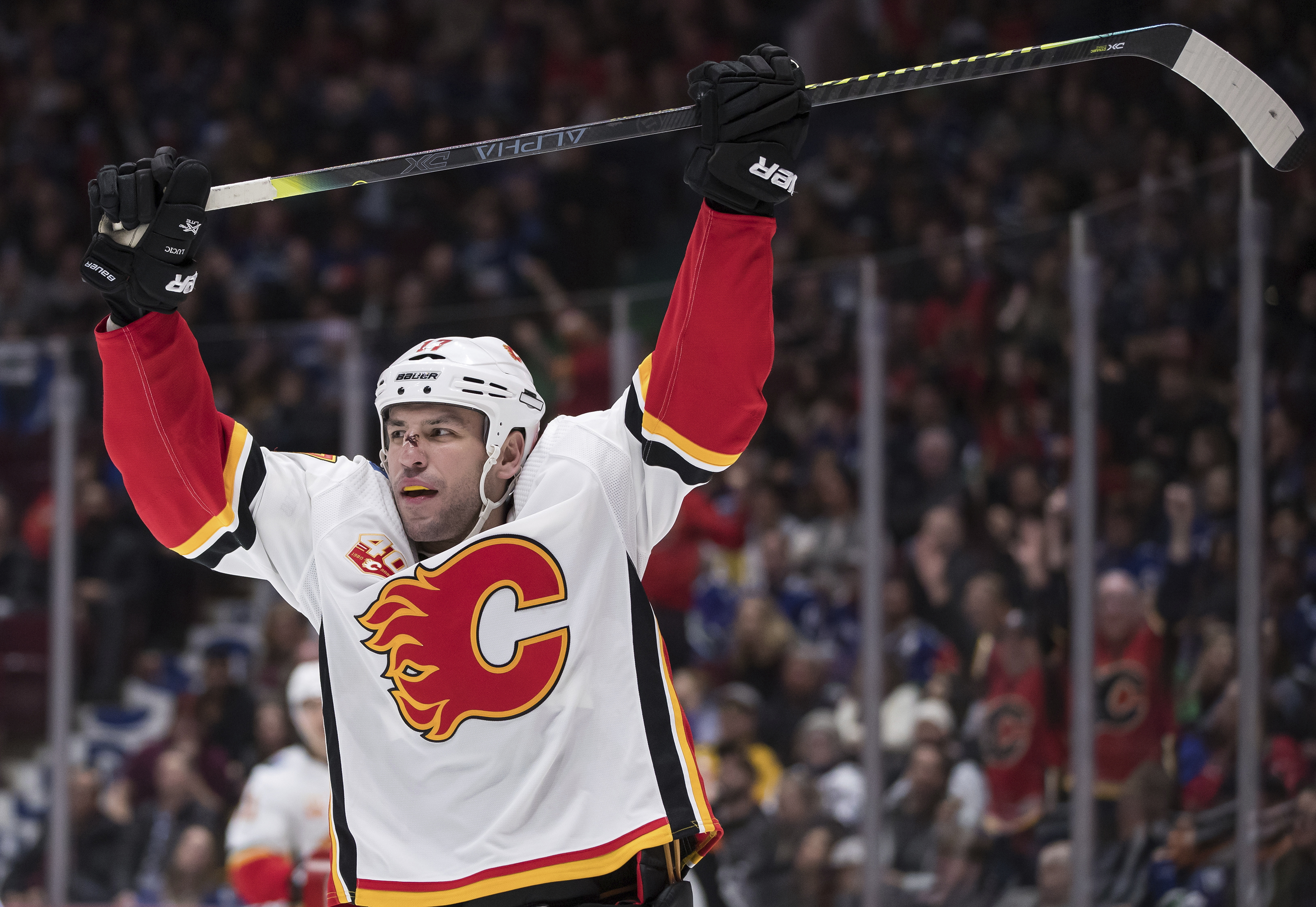Dube has goal, 2 assists as Flames beat Canucks 6-2
