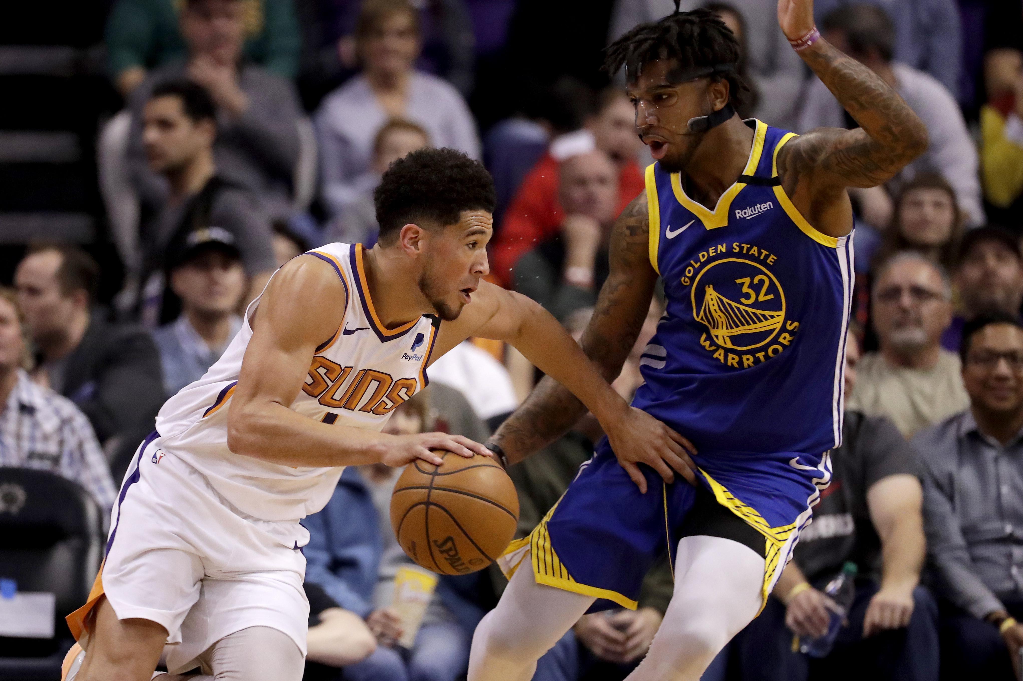 Devin Booker scores 27 points, Suns top Warriors 112-106