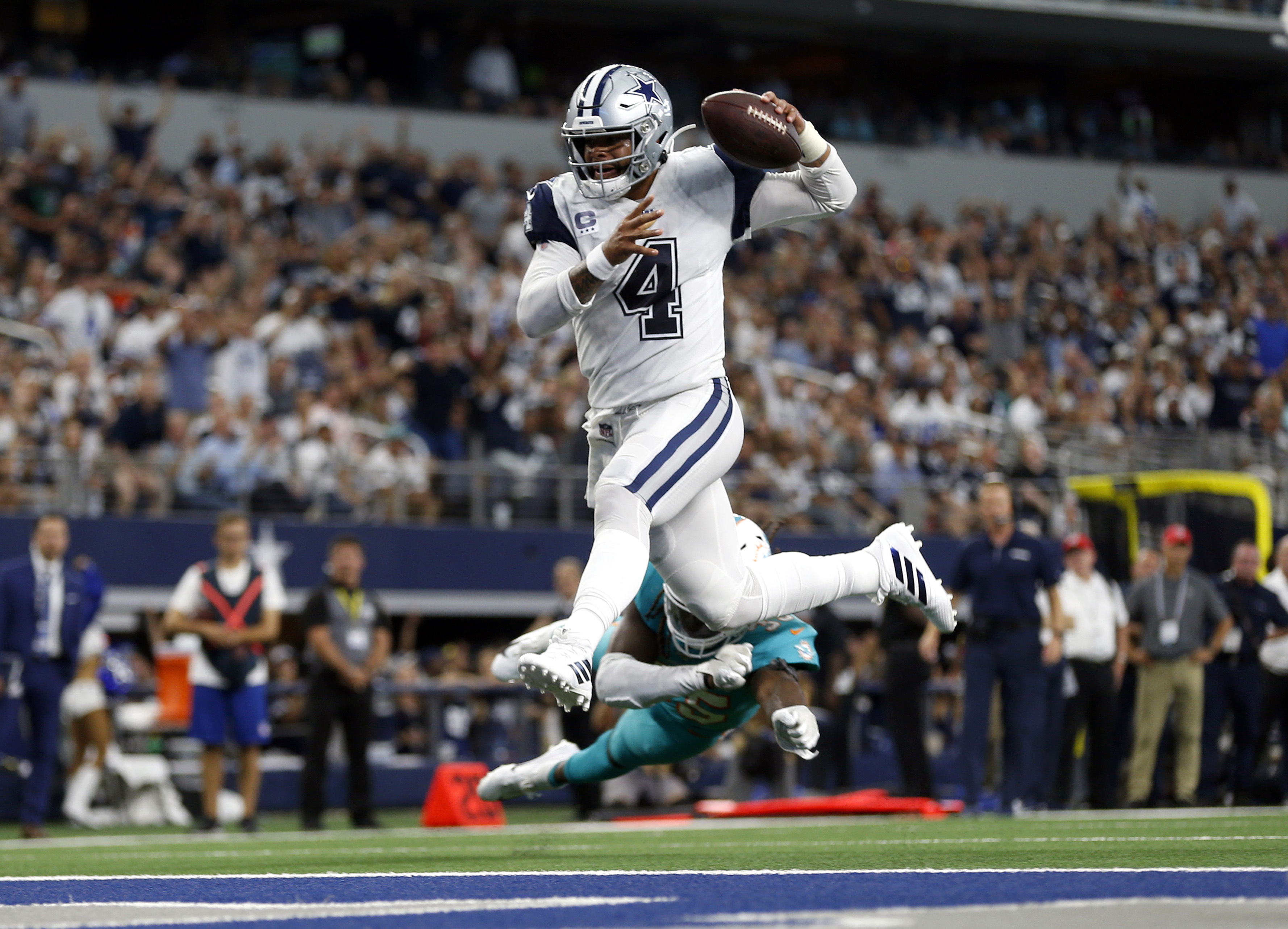 AP source: Cowboys, Cooper agree on deal; Prescott tagged