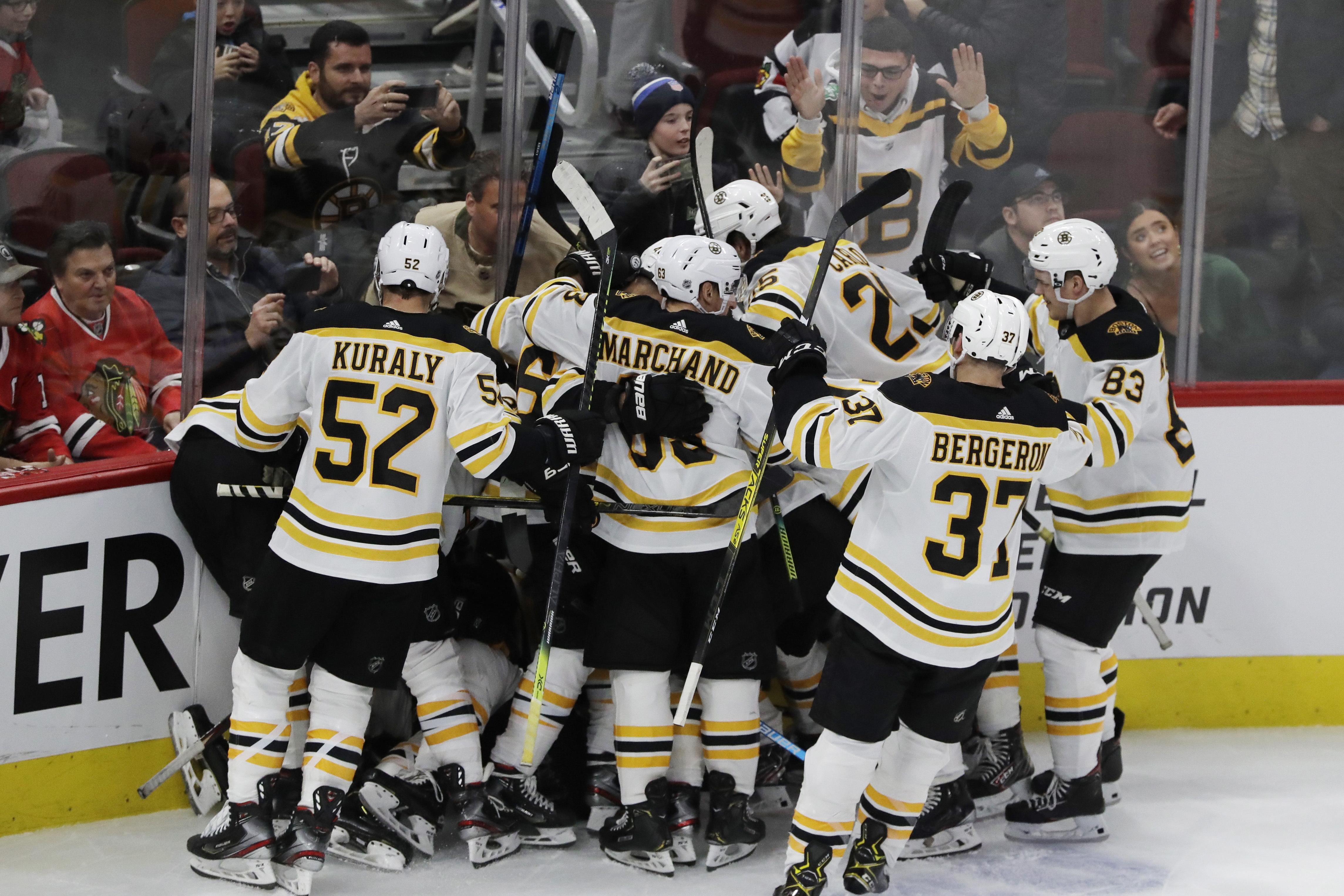 McAvoy lifts Bruins past Blackhawks in OT
