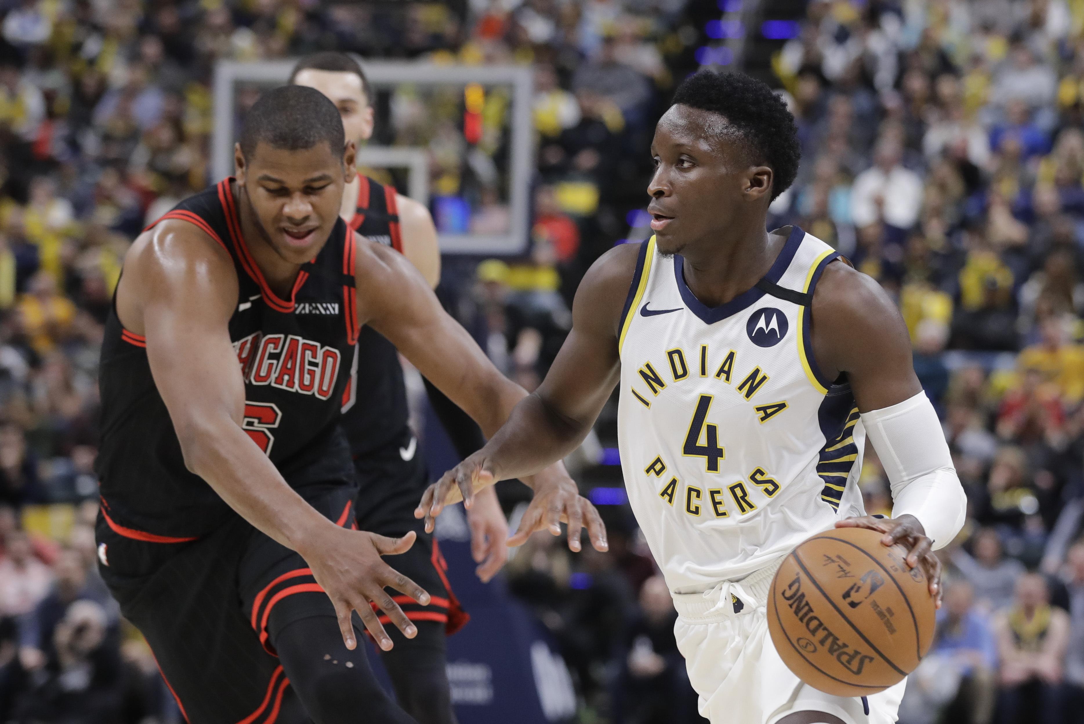 Oladipo hits key 3 in season debut, Pacers top Bulls 115-106