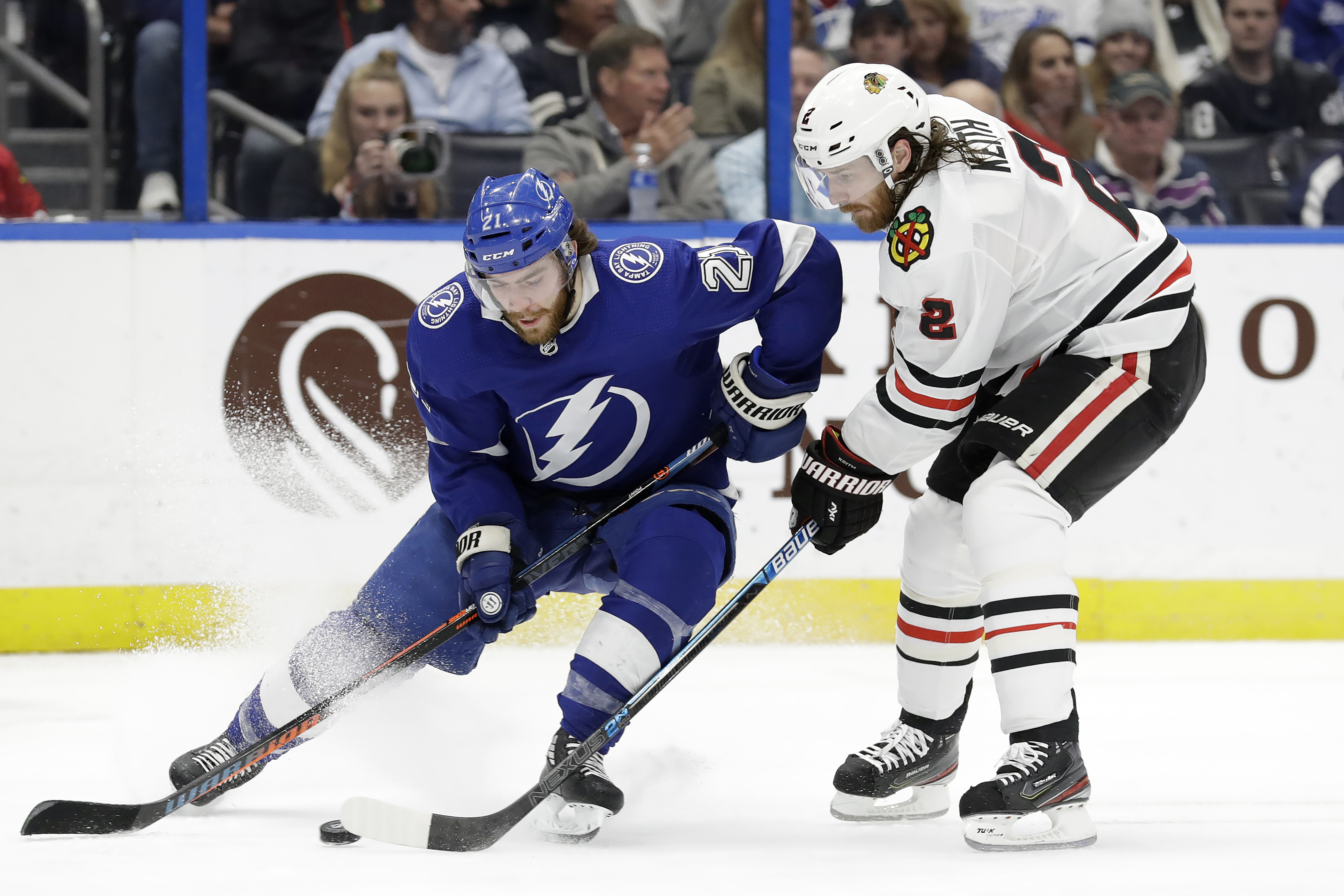 Kubalik records hat trick, Chicago rallies past Tampa Bay