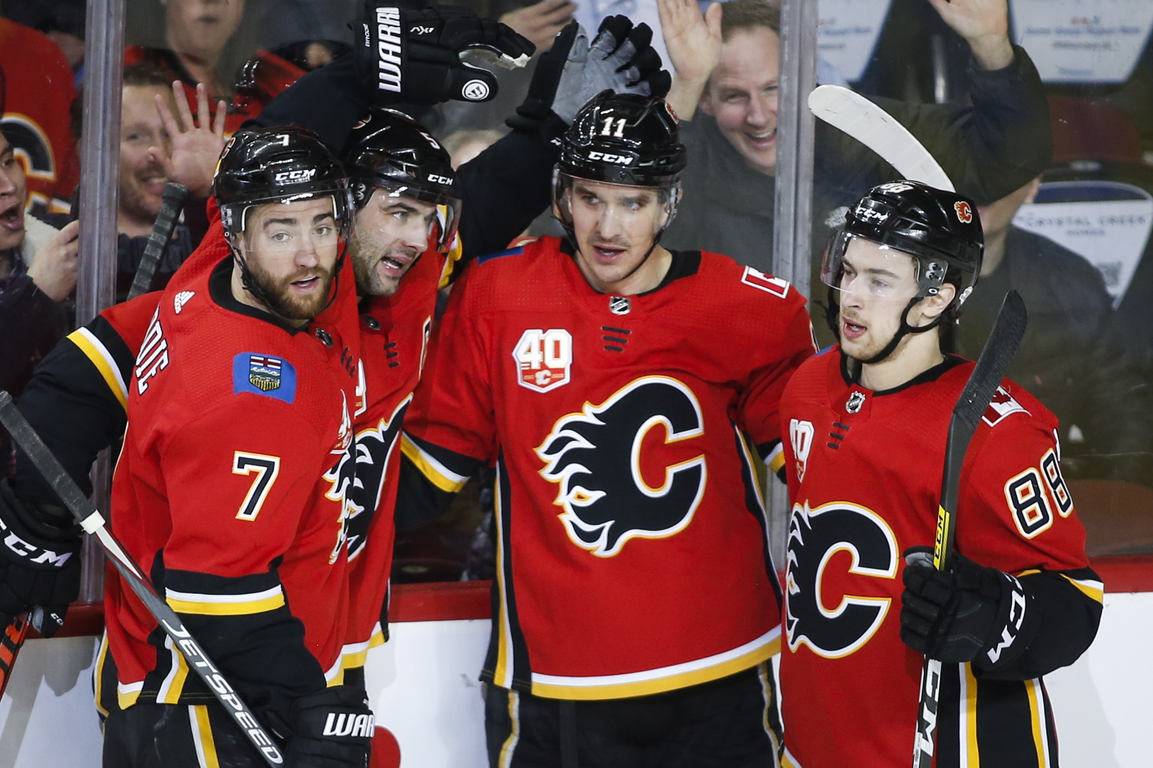 Matthew Tkachuk sets up Flames in 3-2 victory over Coyotes